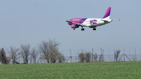Wizzair plane approaching the runway, landing. Wizz Air plane flying up in the sky stock video
