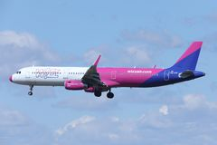 Wizz Air Airbus A321-200 HA-LXA jet flying up in the sky Royalty Free Stock Photos