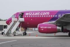 Wizzair stewardess waving Royalty Free Stock Photography