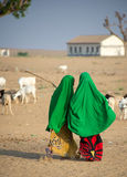 Two young Somali girls walking to school in rural Somalia Stock Images