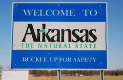 Wlcoome till det Arkansas tecknet på blå himmel royaltyfri bild