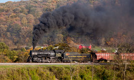 WM Steam train powers along railway Stock Photo