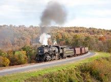 WM Steam train powers along railway Stock Images