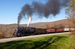 WM Steam train powers along railway Royalty Free Stock Photos