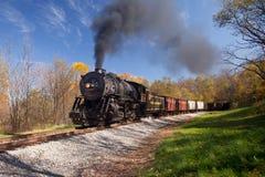 WM Steam train powers along railway Royalty Free Stock Photography