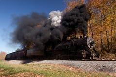 WM Steam train powers along railway Stock Photo