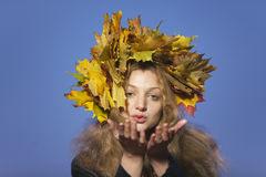 Wman with crown of maple leaves Stock Photos