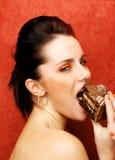 Wman mangeant le gâteau, Gluttony - les sept péchés mortels Image libre de droits