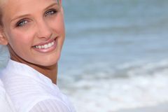 Wman stood on the beach. Attractive blond woman stood on the beach Royalty Free Stock Images