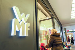 WMF. Sign next to the entrance of one of their stores with copy space to the right Stock Photo