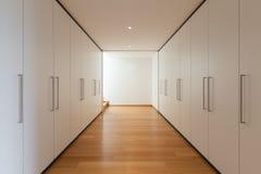 Wnętrze, długi korytarz z garderobami Obrazy Royalty Free