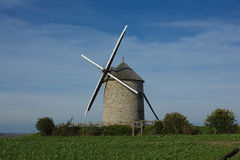 Wndmill in fields of France Royalty Free Stock Photo