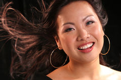 Wndy hair asian smiling Stock Photos