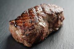 Wołowina stek od antrykot części na łupek desce Obrazy Royalty Free