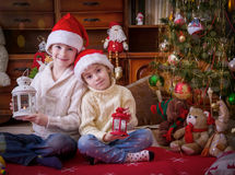 Wo children with lanterns under Christmas tree Stock Photography