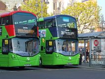 Wo first buses stopped near leeds market in leeds city centre. Leeds, west yorkshire, england: 17 april 2019: two first buses stopped near leeds market in leeds stock photo
