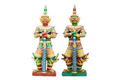 Wo giant statues guard in the temple of Buddhism at Bangkok Thailand with isolate on white background. Two giant statues guard in the temple of Buddhism at royalty free stock image