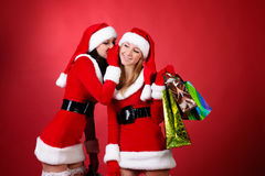 Wo happy young Santa girl talking Royalty Free Stock Photos