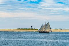 Wo-masted yacht and Beautiful landscape of ocean beach Cape cod Massachusetts. US Stock Image
