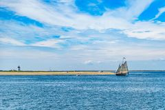 Wo-masted yacht and Beautiful landscape of ocean beach Cape cod Massachusetts. US Royalty Free Stock Photo