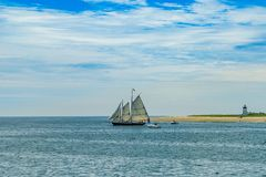 Wo-masted yacht and Beautiful landscape of ocean beach Cape cod Massachusetts. US Royalty Free Stock Images