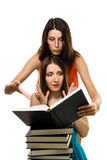 Wo shocked woman look into book stock photography
