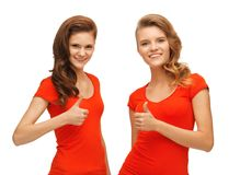 Wo teenage girls in red t-shirts showing thumbs up Royalty Free Stock Photos