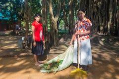 Wo women cleaning tha path in Sigiriya garden complex, Stock Photo