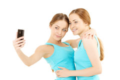 Wo women make the photo to mobile phone Royalty Free Stock Photography