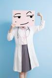 Woamn doctor take surprise billboard Stock Photo