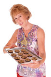 Woamn offering cookies Royalty Free Stock Images