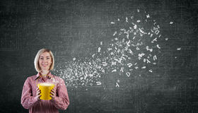 Woamn splashing charcters from bucket Royalty Free Stock Images
