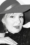 Woamn with wide brimmed hat. Attractive wealthy looking blonde woman in wide brimmed hat looking directly at you the viewer with lips parted in black and white Stock Images
