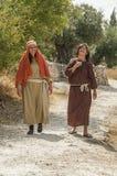 Woan and girl walking in nazareth in Israel stock photos