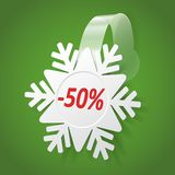 Wobbler with White Snowflake. Editable background. Snowflake wobbler  on a green background. Transparent strip - editable background color Royalty Free Stock Photo