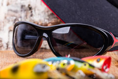Wobblers удя приманок крупного плана с солнечными очками Стоковая Фотография RF