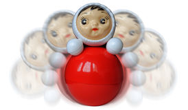 Wobbling roly-poly toy on white. Isolated child-face red wobbling weeble Royalty Free Stock Photo