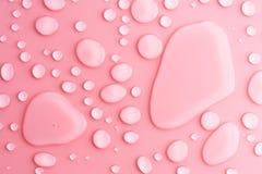 wod kropel różowy tło Zdjęcia Stock