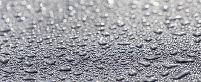 Wod krople na kruszcowej powierzchni Zdjęcie Stock