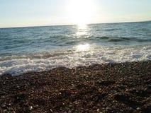 Woda, morze, słońce, wschód słońca lekki, jaskrawy, promień, plaża, piasek piękny, piękny, fale, piankowate, odpoczywa, podróżuje zdjęcie stock