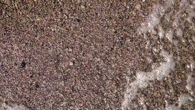 Woda myje plażowego zakończenie up swobodny ruch Odgórny widok zbiory
