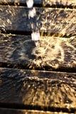 Woda opuszcza chełbotanie fotografia royalty free