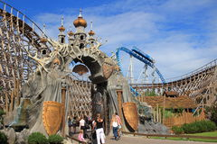 Wodan wooden roller coaster gateway. People strolling through the gateway of Wodan-Timburcoaster which is themed to Norse mythology (Europa Park Rust Royalty Free Stock Photo
