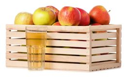A wodden box of apples a glass of apple juice. On a white background Isolation Stock Images