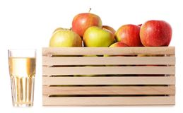 A wodden box of apples a glass of apple juice. On a white background Isolation Stock Image