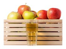 A wodden box of apples a glass of apple juice. On a white background Isolation Stock Photos