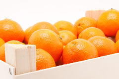 Wodden box full of mandarines on white background Royalty Free Stock Photography