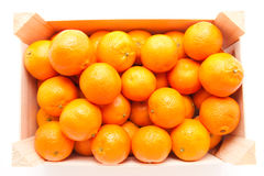 Wodden box full of mandarines on white background Royalty Free Stock Images