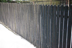 Wodden brown fence with white snow. Texture. Nobody. Stock Photography