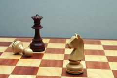 Wodden chess figures. Brown Wodden chess figures in close up Stock Image